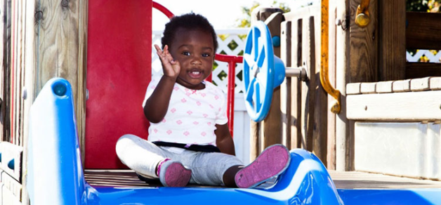 A child playing on a slide
